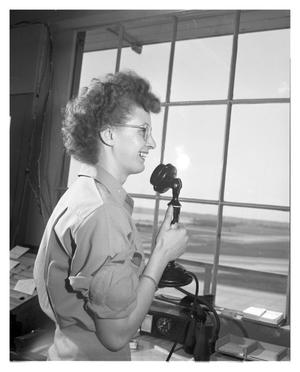 Primary view of object titled '[Corporal Laurabelle Boyd Working as a Control Tower Operator]'.