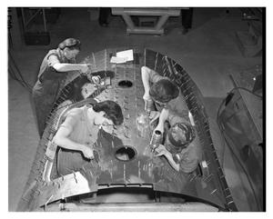 Primary view of object titled '[Four Women Working on the Canopy Section of an Aircraft]'.