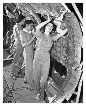 Primary view of object titled '[Three Women Work on Center Wing Section]'.
