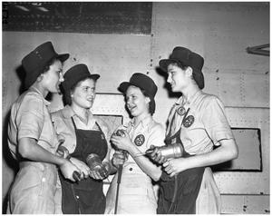 Primary view of object titled '[Four Women Wearing Safety Caps]'.