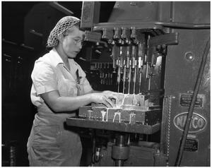 Primary view of object titled '[Woman Working with Machinery]'.