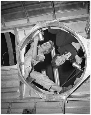 Primary view of object titled '[Two Women Working on Nose Fuselage]'.