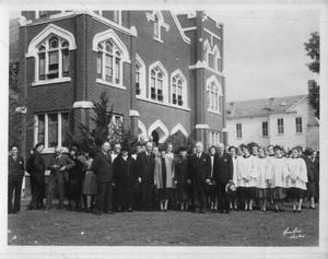 Primary view of object titled '[The First Methodist Church and members during their 100th anniversary.]'.