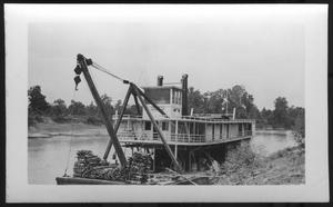 Primary view of object titled '[Boat near the bank of a river. Location unknown.]'.