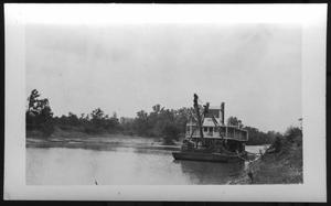Primary view of object titled '[A Boat Located Close to River Bank. Location Unknown.]'.