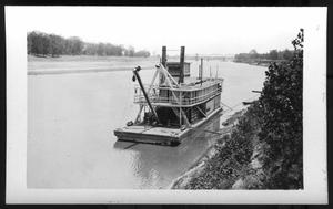 Primary view of object titled '[A Boat Close to River Bank. Location Unknown.]'.