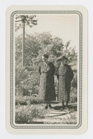 [Annie Sharpe and Elizabeth Brown Standing in a Yard]