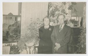 Primary view of object titled '[Annie and John Sharpe Posing with Plants]'.