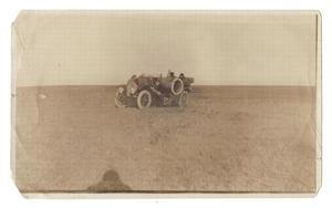 [Pierce-Arrow automobile stopped in field]