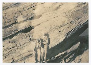 Primary view of object titled '[Two Men Standing Against Rock Wall at Lovers' Retreat]'.