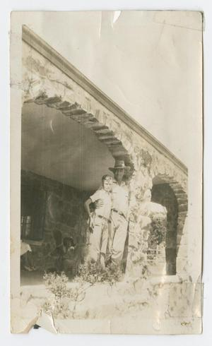 Primary view of object titled '[Man and a Boy Standing on a Porch]'.