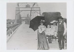 Primary view of object titled '[Withers Family on Brazos River Bridge]'.