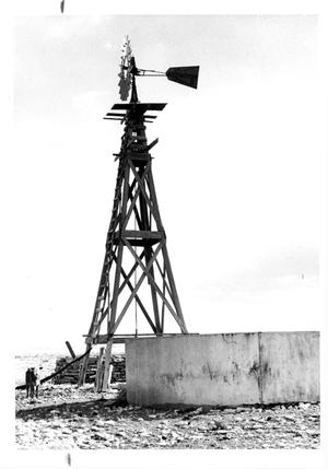 Primary view of object titled 'Aermotor Windmill beside Water Tank'.