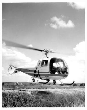 Primary view of object titled 'Helicopter Lifting Off at SMS Ranch'.