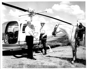 Primary view of object titled 'W.G. Swenson Getting into a Helicopter'.