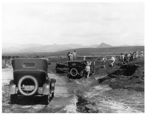 Primary view of object titled 'Pulling an Automobile across a Stream in 1920'.