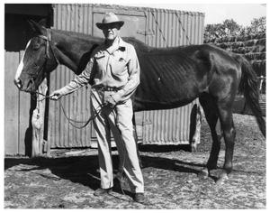 Primary view of object titled 'Dr. R.A. Duncan and his horse, Streak'.
