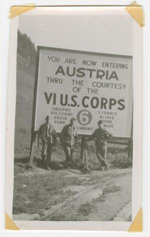 Primary view of object titled '[Three Soldiers Standing by a Sign for Austria]'.