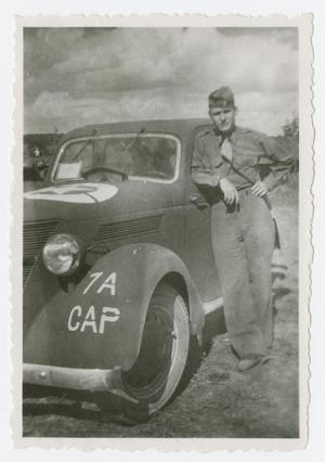 Primary view of object titled '[Lieutenant Johnson Beside Car]'.