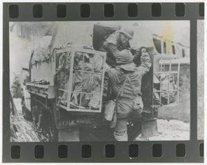 Primary view of object titled '[Medics Mounting a Half-Track]'.
