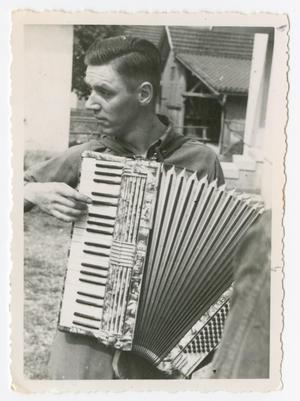 Primary view of object titled '[Soldier Playing Accordion]'.