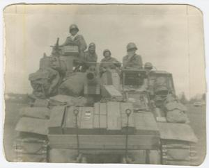 Primary view of object titled '[Robert Campbell and Crew Members on a Tank]'.