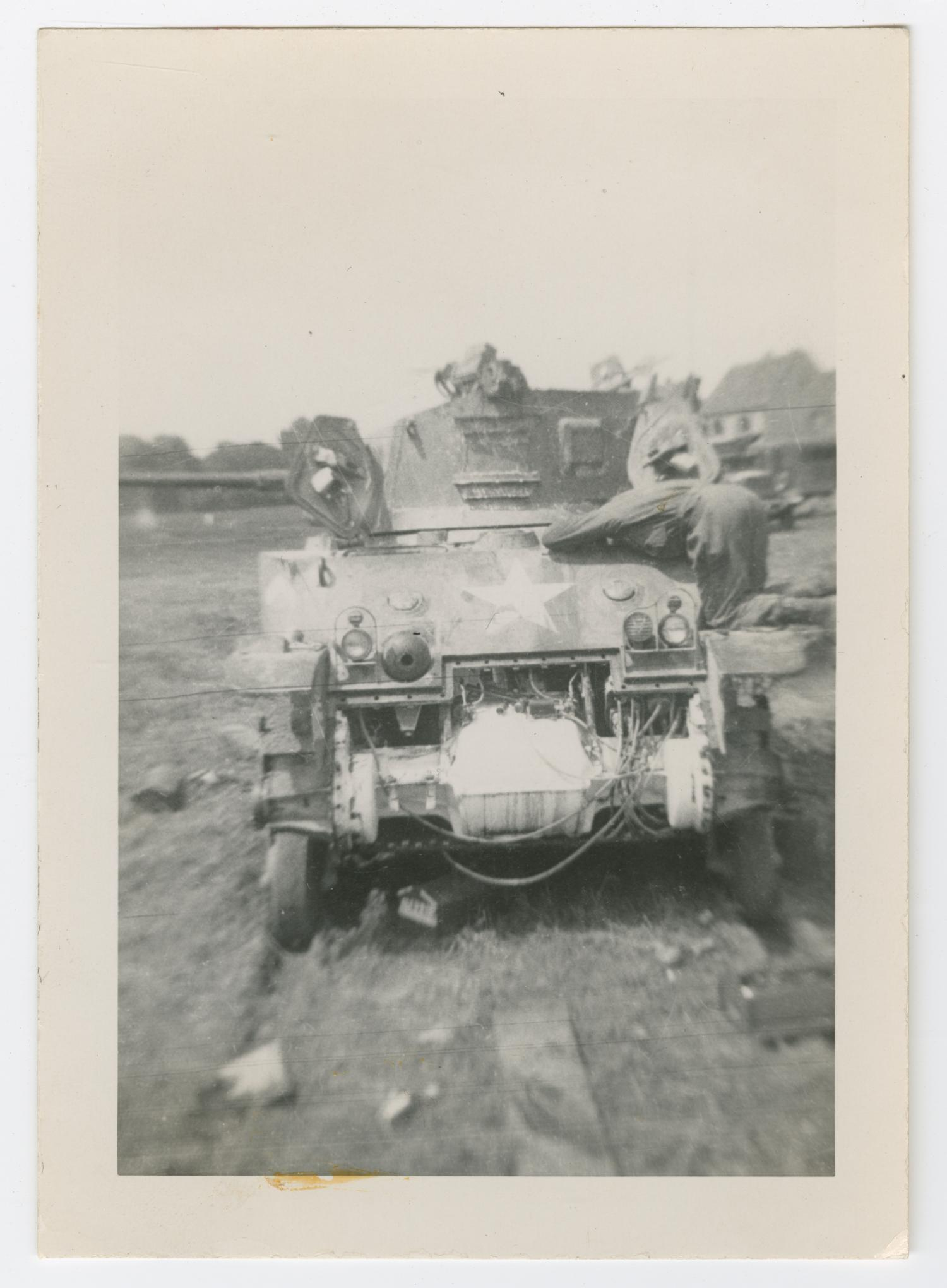 [Soldier Repairing an M5 Tank]                                                                                                      [Sequence #]: 1 of 2