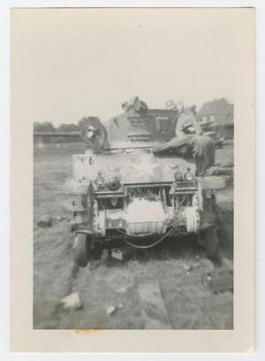 Primary view of object titled '[Soldier Repairing an M5 Tank]'.