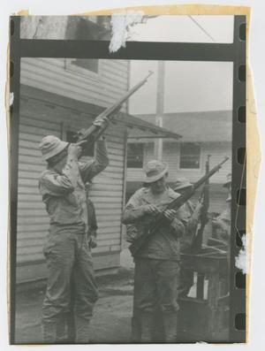 Primary view of object titled '[Soldiers Cleaning Rifles at Camp Campbell]'.