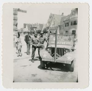 Primary view of object titled '[Soldiers Standing by Jeep]'.