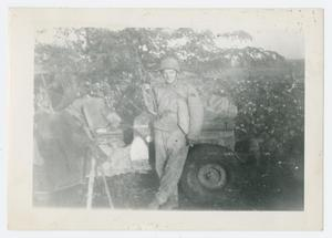 Primary view of object titled '[Soldier in Front of Jeep]'.