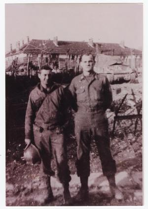 Primary view of object titled '[James Sadler and Pete Vickless in Front of Zimming Barracks]'.