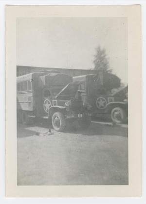 Primary view of object titled '[Two GMC CCKW Trucks with Open Hoods]'.