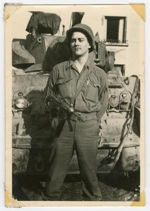 Primary view of object titled '[William Hahn in Front of a Tank]'.