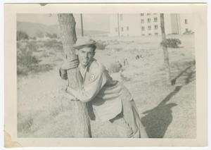 Primary view of object titled '[William Giannopoulos Hugging a Tree]'.