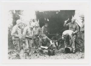 Primary view of object titled '[Nine Soldiers by a Lean-To in France]'.