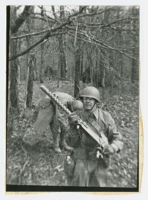 Primary view of object titled '[Soldier Carrying a .50 Caliber Machine Gun]'.