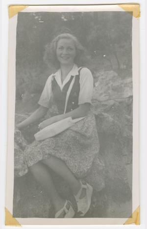 Primary view of object titled '[Annie Marchal Sitting on a Rocky Outcropping]'.
