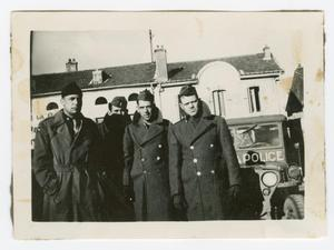 Primary view of object titled '[Four Soldiers Standing by a Car]'.