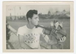 Primary view of object titled '[William Giannopoulos Playing a Backwards Fiddle]'.