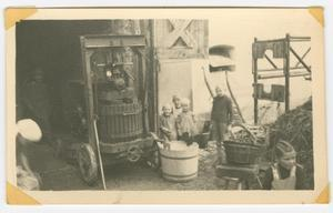 Primary view of object titled '[German Children Beside an Apple Press]'.