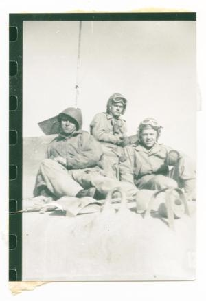 Primary view of object titled '[Three Soldiers Sitting Atop a Tank]'.