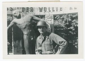 Primary view of object titled '[George Hatt Beside War Memorial]'.