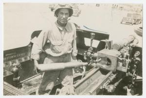 Primary view of object titled '[Soldier Loading Artillery Gun]'.