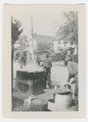 Primary view of object titled '[William Giannopoulos Operating a Grill]'.