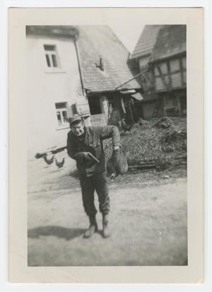 Primary view of object titled '[William Giannopoulos Holding a Pistol and a Chicken]'.