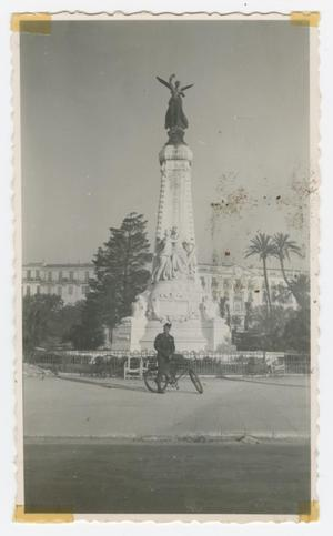 "Primary view of object titled '[Soldier on Bicycle in Front of ""Le Monument du Centenaire""]'."