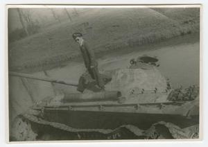 Primary view of object titled '[Richard Koos Standing on a Wrecked German Tank]'.