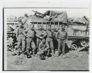 Primary view of object titled '[Six Soldiers Posing Against a Tank]'.