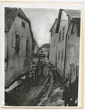 Primary view of object titled '[Army Medics Moving Between Houses]'.